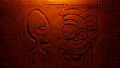 Fire Lights Alien And Aztec Man In Wall Carving 54057884