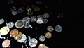 Coins fall in water. Slow motion. 54078585