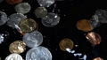 Coins fall in water. Slow motion. 54078587