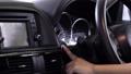 driver pushing car engine start-stop button 54109005