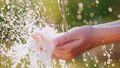 A stream of clear water falls in the palm of your hand. Slow Motion Video 54119907