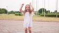 Little joyful barefoot girl jumping in puddle and having fun 54169131