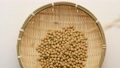 Falling Soybeans on a bamboo basket. 54176961