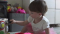 Cute baby girl playing with toy at home 54198336