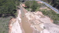 aerial sand extraction works on shallow river by motorway 54199788