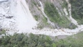 high canyon slope covered with rocks stones after landslide 54200313
