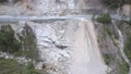 flycam films canyon slope landslide with scooters on road 54200315