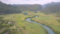 pictorial calm blue river reflects trees near green fields 54200316