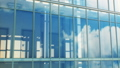 Beautiful Abstract Modern Building Facade with Sky and Clouds Reflecting Seamless. Looped 3d 54204787