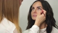 Make-up artist putting on make-up on model's eyes 54242570