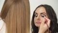 Eye make-up. Professional makeup artist makes girl 54242578