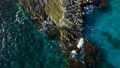 Aerial top view: sea waves wash the stones 54257558