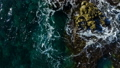 Aerial top view: sea waves wash the stones 54257560