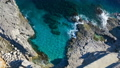 Aerial top view: sea waves wash the stones 54258561