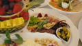 a plate of sweets and fruit 54274624
