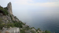 Seascape from Caraul-Oba mountain. Juniper bushes on rock. Sudak, Crimea. 54286850