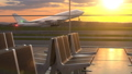 Airplane taking off against scenic sunset seen through departure lounge windows 54297079