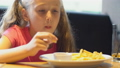 girl eating french fries 54324617