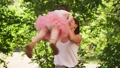 Happy mother whirls with baby in sunny summer park 54325664