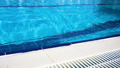 Blue surface water in the pool. Edge the pool. 54329886