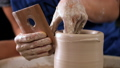 Traditional pottery making,man teacher shows the basics of pottery in art studio 54341897