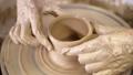 Working process of man's work at potters wheel in art studio.  54341911