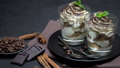 Classic tiramisu dessert with blueberries and strawberries in a glass on stone serving board 54362911