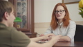 Portrait of adorable woman psychotherapist having session with her patient. Beautiful red-haired 54363986