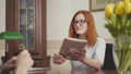 Attractive red-haired young female psychologist in glasses consulting her patient, showing 54363990