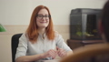 Portrait of pretty woman psychologist having session with her patient. Beautiful red-haired woman 54364005