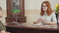 Portrait of woman psychologist having session with her patient. Beautiful red-haired woman 54364008