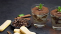 Classic tiramisu dessert in a glass and savoiardi cookies on stone serving board 54416245