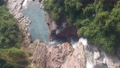Top down aerial view of giant waterfall flowing in Vietnam mountains filmed in slow motion 54421132