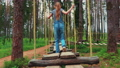 Little girl walking on Low Rope Course 54465739