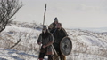 Group of Vikings with shields and swords going forward on the winter meadow. Male, leader. 54530271