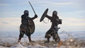 Two warriors viking are fighting with axes and shields on the winter meadow. 54530273
