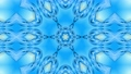 Abstract snowflake in motion of the blue lines of ribbons on a blue background. Kaleidoscopic effect 54557301