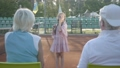Cute funny girl with two pigtails standing on the tennis court holding racket, sending air kisses to 54566607