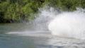 Jet ski on the river. Splashes fly apart. 54582604
