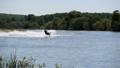 Jet ski on the river. Splashes fly apart. 54582606