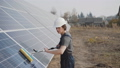 The worker washes solar batteries and looks at camera with crossed hands 54593317