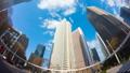 東京 新宿高層ビル街 タイムラプス 超ワイド 魚眼で見上げる摩天楼の青空と雲 fix 54660592