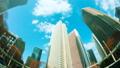 東京 新宿高層ビル街 タイムラプス 超ワイド 魚眼で見上げる摩天楼の青空と雲 カラグレ 54660596