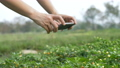 Asian farmer taking photo of plant by smart phone 54686024