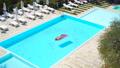 Young woman in bikini air mattress in the big swimming pool 54831078