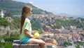 Big yellow lemon in hand in background of mediterranean sea and sky. 54831082