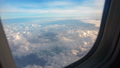 Above clouds, sky as seen in window of an aircraft 54841445