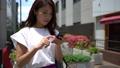 路上でスマホで地図アプリで道を調べる若い日本人女性 54868474