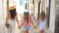 Happy mother and little adorable girls on cozy street during italian vacation. 54884233