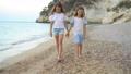 Little girls having fun at tropical beach during summer vacation 54884240